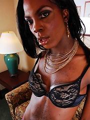 Dark skinned T-girl shows her shecock